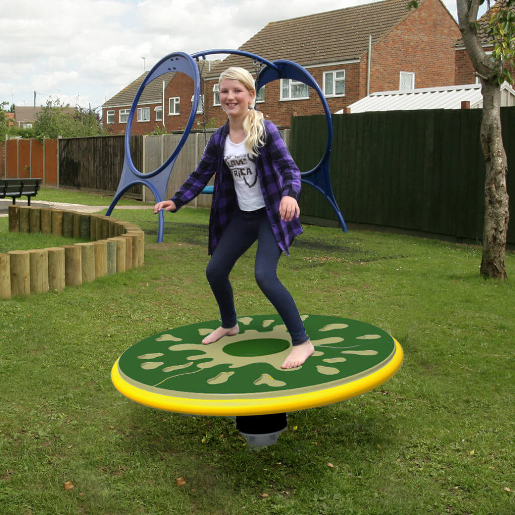 girl playing on wicksteed dizzy roundabout