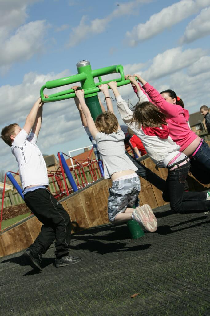 Children using Flymobile roundabout